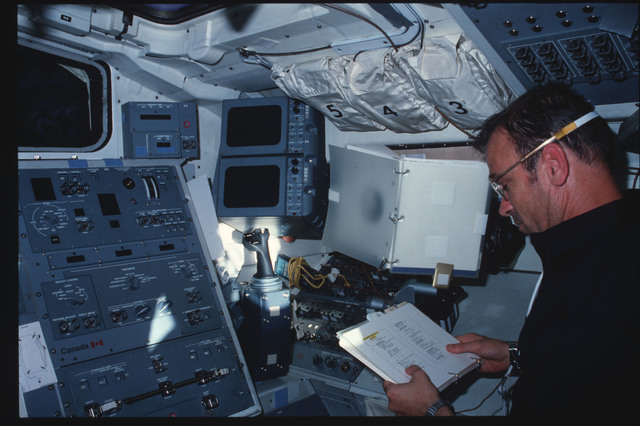 S07-25-1392 - STS-007 - Mission Specialist (MS) Fabian at Aft Flight Deck Onorbit Station (port side)