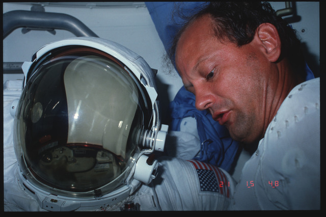 S07-29-1528 - STS-007 - Mission Specialist (MS) Thagard checks EMU systems in airlock
