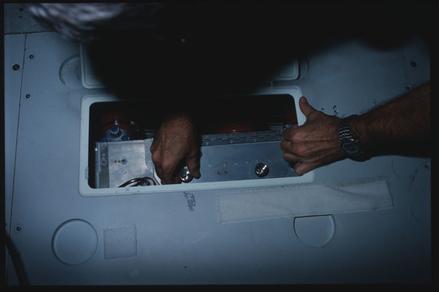 S08-13-334 - STS-008 - Commander Truly and Pilot Brandenstein clean ARS filters on middeck