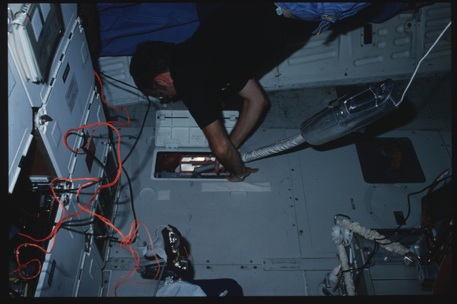 S08-13-336 - STS-008 - Commander Truly and Pilot Brandenstein clean ARS filters on middeck