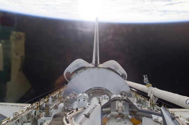 S100E5002 - STS-100 - Endeavour's payload bay with the Raphaello module and Canadarm 2
