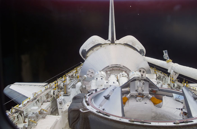 S100E5014 - STS-100 - Endeavour's payload bay with the Raphaello module and Canadarm 2