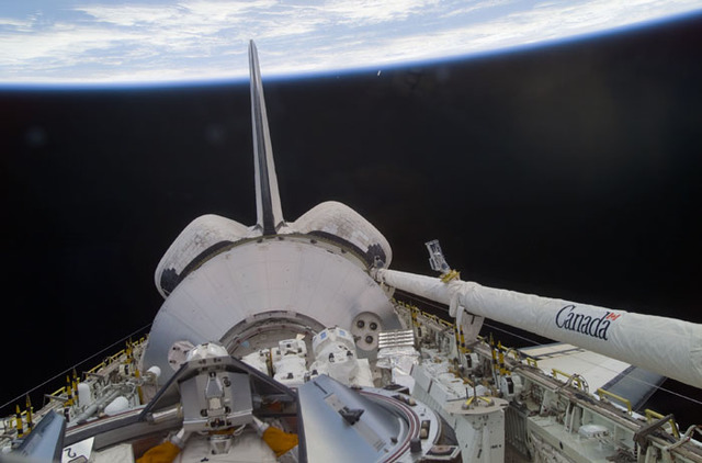 S100E5015 - STS-100 - Endeavour's payload bay with the Raphaello module and Canadarm 2