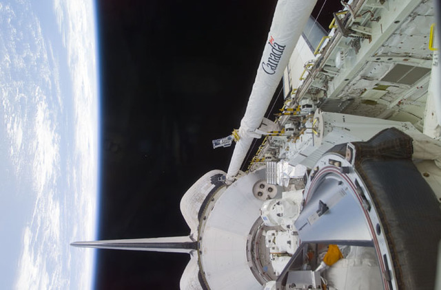 S100E5017 - STS-100 - Endeavour's payload bay with the Raphaello module and Canadarm 2