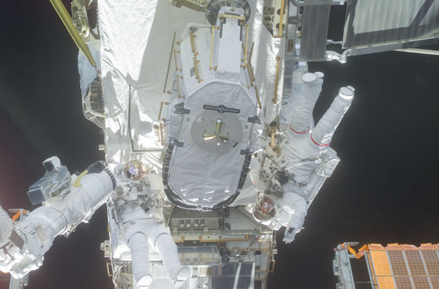 S105E5269 - STS-105 - Barry and Forrester stow the EAS on the P6 Truss