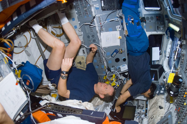S107E05687 - STS-107 - Brown exercises as Ramon types on a laptop on Columbia's AFD during STS-107