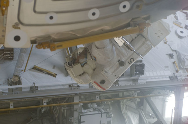 S110E5593 - STS-110 - MS Smith at work around the U.S. Laboratory during the third EVA of STS-110