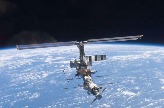 S110E6043 - STS-110 - Aft - zenith view of the ISS taken during STS-110's undocking and final flyaround