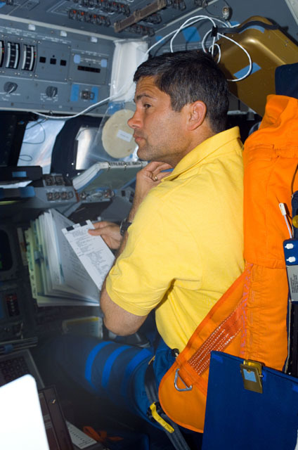 S111E5005 - STS-111 - Lockhart reviews a checklist from the PLT's seat on Shuttle Endeavour's FD during STS-111 UF-2