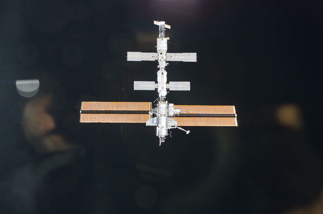 S111E5013 - STS-111 - View of the ISS against the blackness of space as photographed by an STS-111 UF-2 crewmember