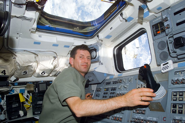 S111E5071 - STS-111 - Treschev at Endeavour's AFD RMS controls during STS-111 UF-2