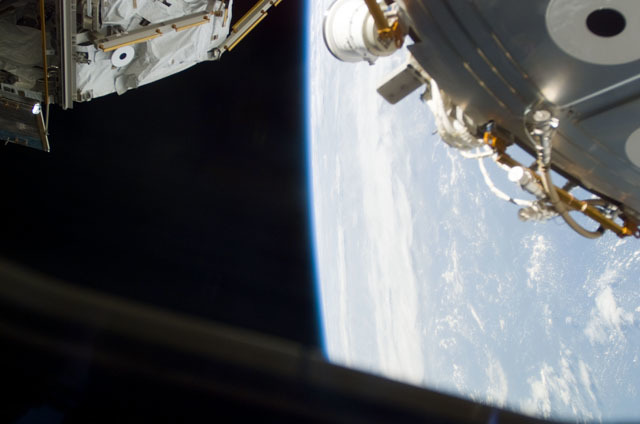S111E5074 - STS-111 - AFD window view of Earth,PMA2 and RMS taken during STS-111 UF-2