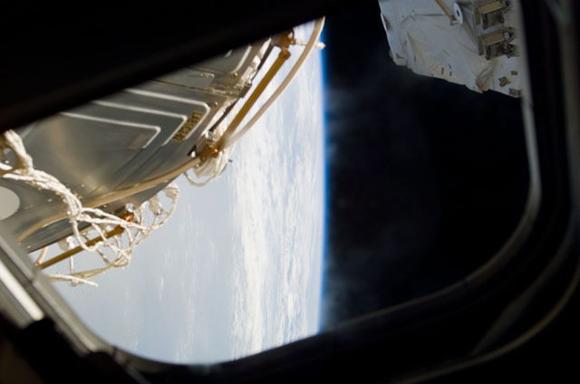 S111E5075 - STS-111 - AFD window view of Earth and RMS taken during STS-111 UF-2