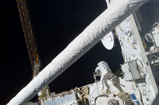S111E5127 - STS-111 - Perrin works with the MBS in Endeavour's PLB during STS-111 UF-2 EVA 1