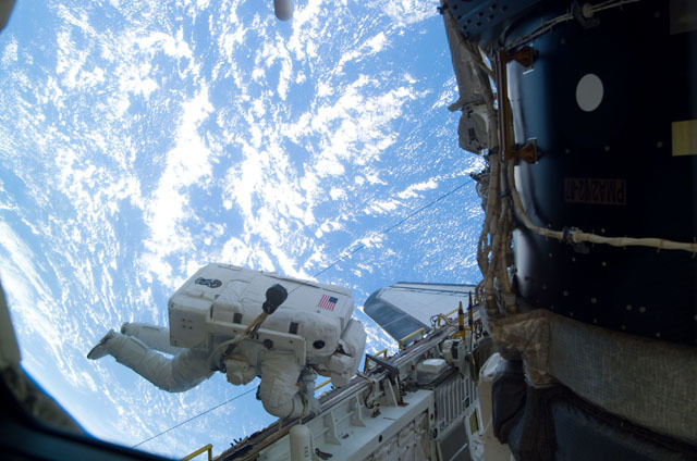 S111E5138 - STS-111 - MBS grappled to the Canadarm2 SSRMS during STS-111 UF-2 installation OPS on the ISS truss structure