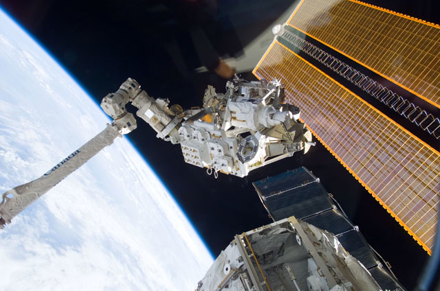 S111E5140 - STS-111 - MBS grappled to the Canadarm2 SSRMS during STS-111 UF-2 installation OPS on the ISS truss structure