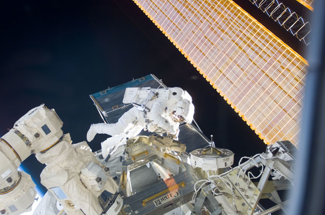 S111E5174 - STS-111 - Canadarm2 SSRMS grappled to the MBS during STS-111 UF-2 installation OPS on the ISS truss structure