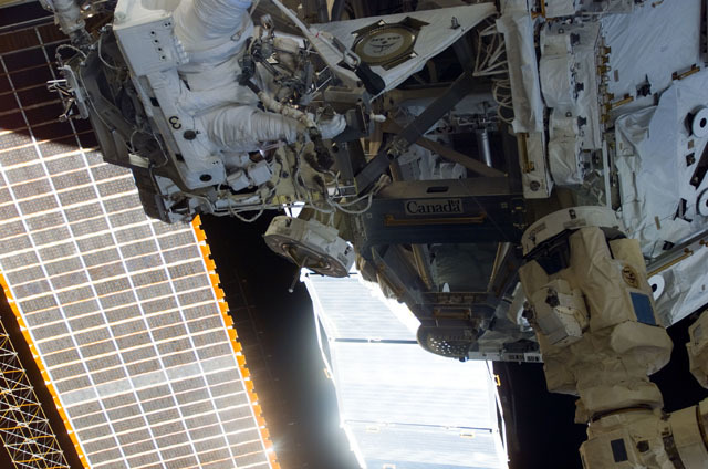 S111E5176 - STS-111 - Canadarm2 SSRMS grappled to the MBS during STS-111 UF-2 installation OPS on the ISS truss structure