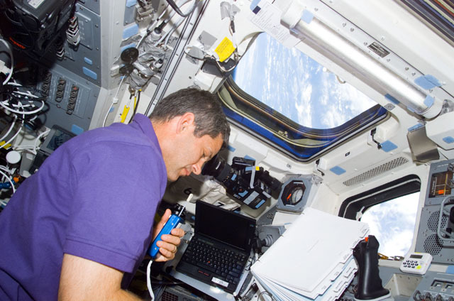 S111E5315 - STS-111 - Lockhart converses on a microphone on Endeavour's AFD during STS-111 UF-2UF-2