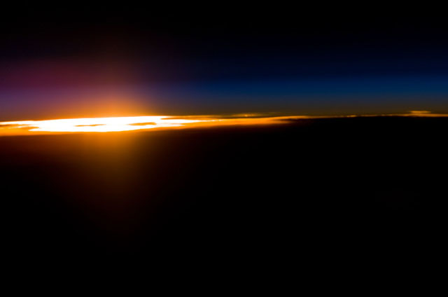 S111E5453 - STS-111 - Orbital sunset as seen during STS-111 UF-2