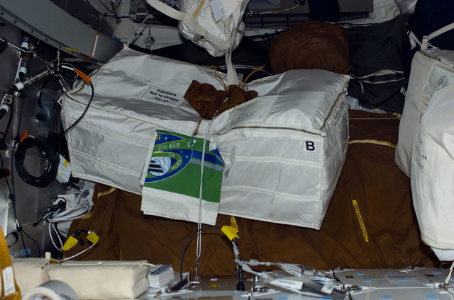 S112E05402 - STS-112 - Stowage bags on the middeck