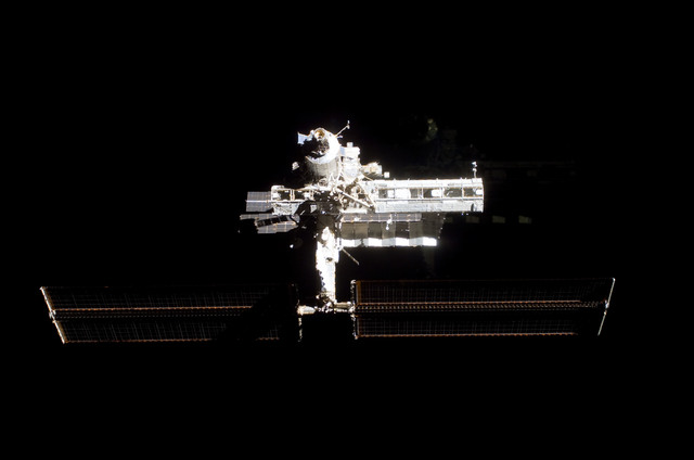 S112E05797 - STS-112 - Flyaround view of ISS forward zenith side