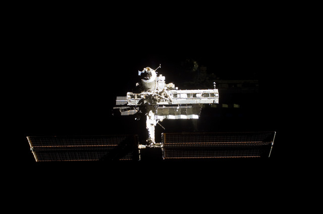 S112E05799 - STS-112 - Flyaround view of ISS forward zenith side
