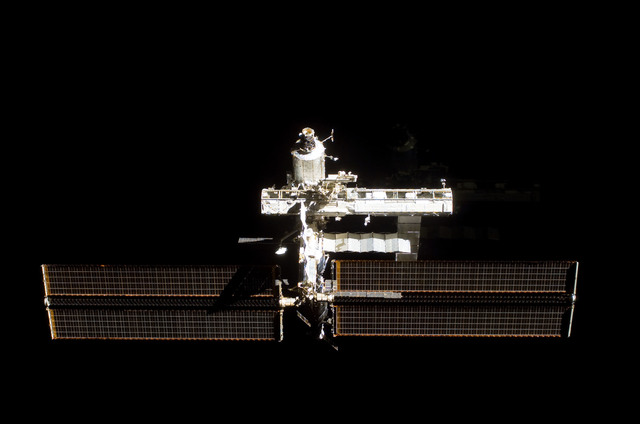S112E05801 - STS-112 - Flyaround view of ISS forward zenith side
