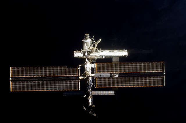 S112E05804 - STS-112 - Flyaround view of ISS forward zenith side