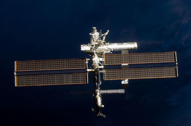 S112E05806 - STS-112 - Flyaround view of ISS forward zenith side
