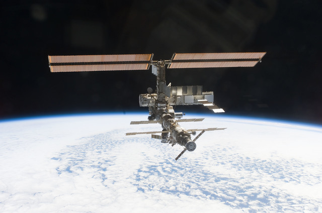 S112E05823 - STS-112 - Flyaround view of ISS zenith aft and port sides