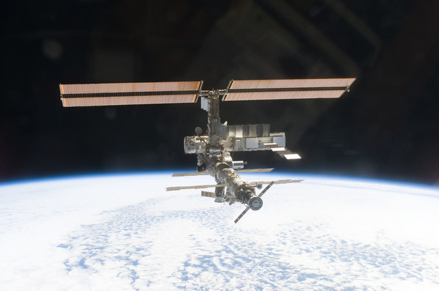 S112E05824 - STS-112 - Flyaround view of ISS zenith aft and port sides