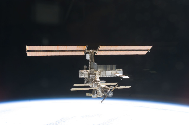 S112E05826 - STS-112 - Flyaround view of ISS zenith aft and port sides