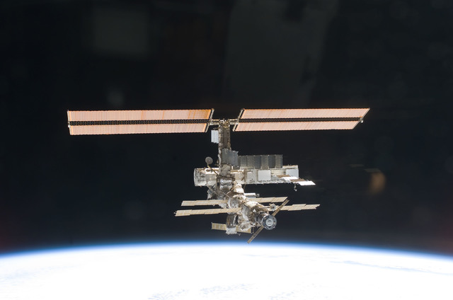 S112E05828 - STS-112 - Flyaround view of ISS zenith aft and port sides