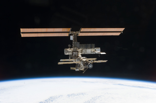 S112E05829 - STS-112 - Flyaround view of ISS zenith aft and port sides