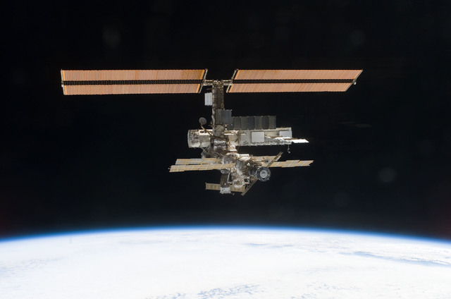 S112E05833 - STS-112 - Flyaround view of ISS zenith aft and port sides