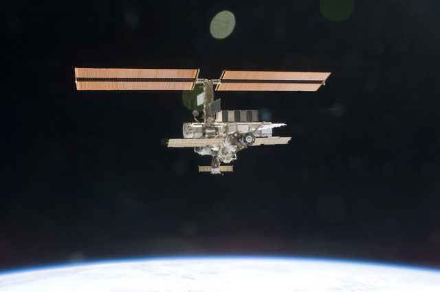 S112E05835 - STS-112 - Flyaround view of ISS aft and port sides