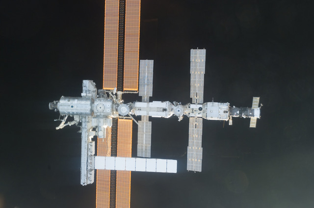 S112E05843 - STS-112 - Flyaround view of ISS nadir sides