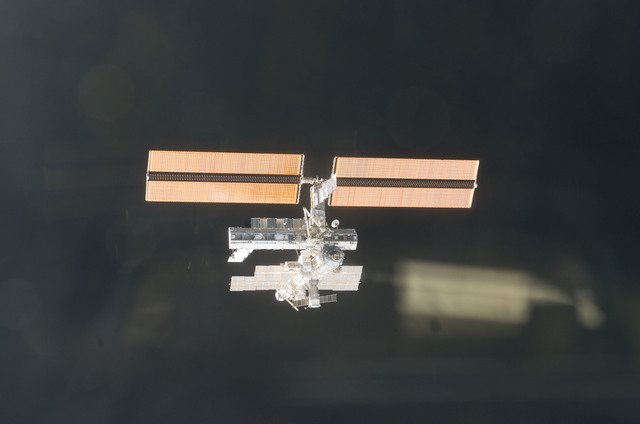 S112E05847 - STS-112 - Flyaround view of ISS aft and port sides