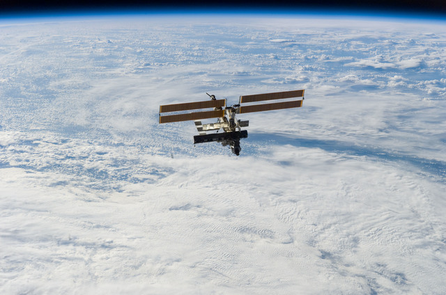 S112E05868 - STS-112 - Flyaround view of ISS zenith aft and port sides