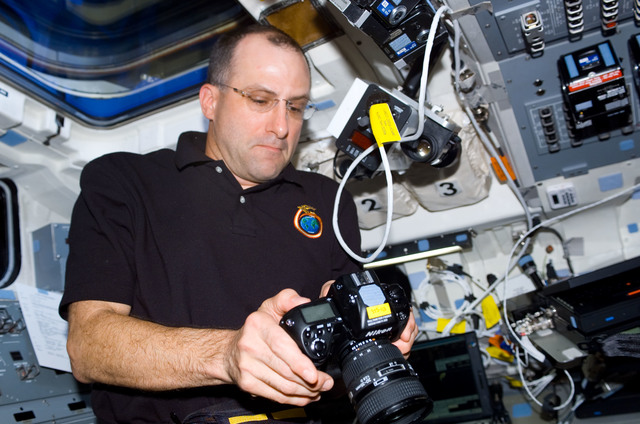 S113E05021 - STS-113 - Expedition Six Flight Engineer Don Pettit works on AFD during STS-113