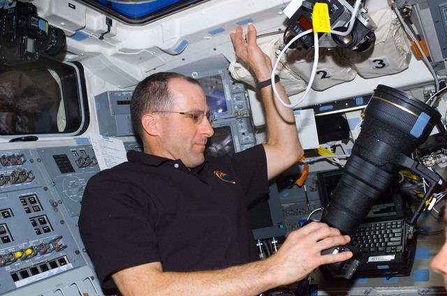 S113E05023 - STS-113 - Expedition Six Flight Engineer Don Pettit adjusts camera on AFD during STS-113
