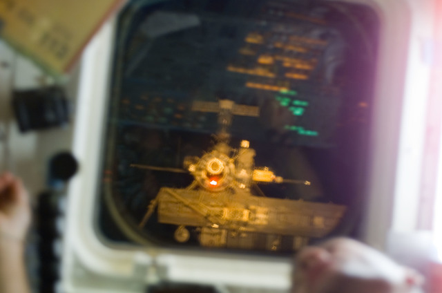 S113E05082 - STS-113 - ISS visible through AFD window during ISS Rendezvous and Docking for STS-113