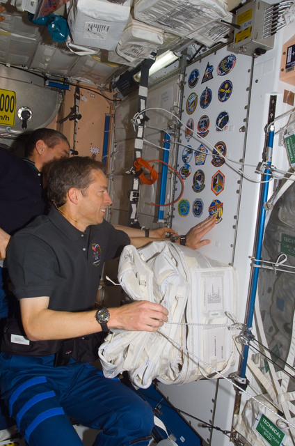 S113E05385 - STS-113 - Wetherbee places mission sticker on panel in Node 1 during STS-113 / EXP. 5