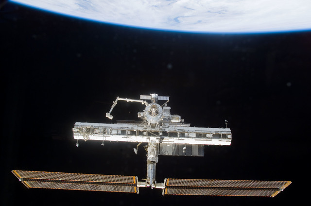 S113E05411 - STS-113 - Forward view of the ISS taken during flyaround operations following STS-113 undocking