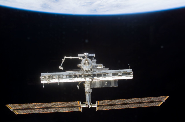 S113E05412 - STS-113 - Forward view of the ISS taken during flyaround operations following STS-113 undocking