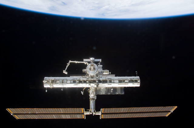 S113E05413 - STS-113 - Forward view of the ISS taken during flyaround operations following STS-113 undocking