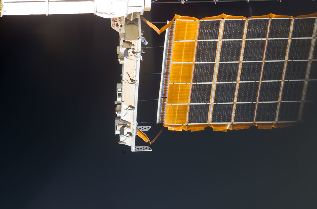 S113E05429 - STS-113 - Partial view of the port PV Array taken during flyaround following STS-113 undocking