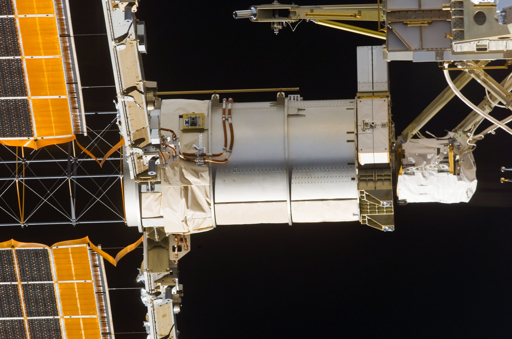 S113E05431 - STS-113 - Mast canister on the STBD PV Array taken during flyaround following STS-113 undocking