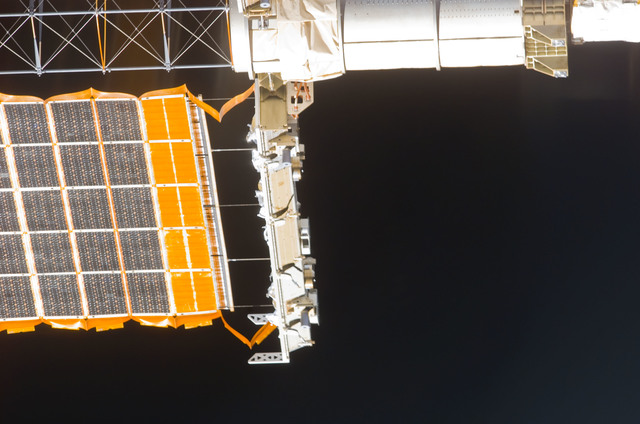 S113E05432 - STS-113 - Partial view of the STBD PV Array taken during flyaround following STS-113 undocking